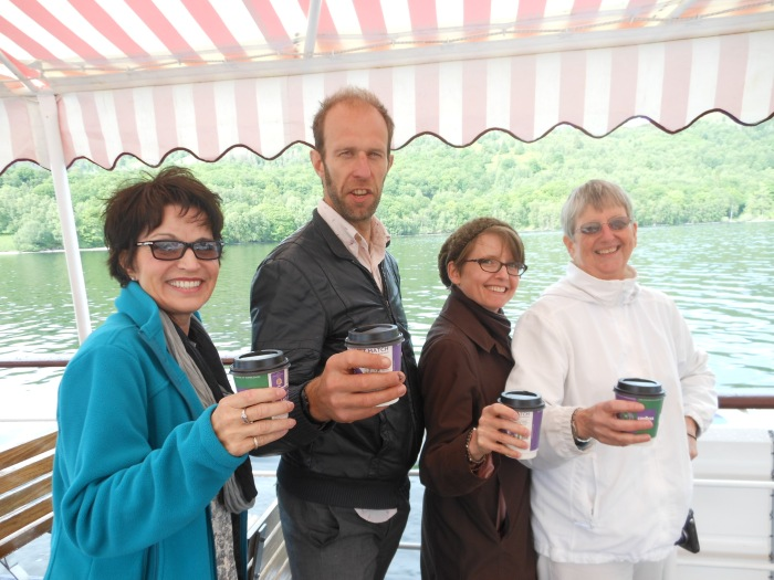 Mary Jo, Daniel, me, and my mom enjoying our Rob Roy Specials (hot chocolate with brandy) on the Sir Walter Scott at Loch Katrine in the the Trossachs.