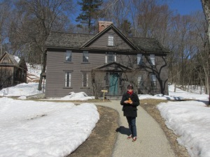 In my Red Sox's cap in front of Louisa May Alcott's House.